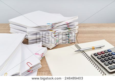 Pen On Notebook With Calculator White Background And Copy Space