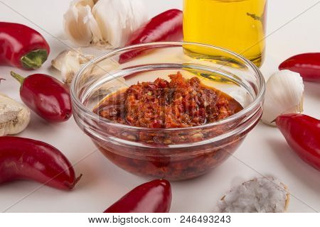 Ground Chilli Peppers In Extra Virgin Olive Oil And Crushed Garlic