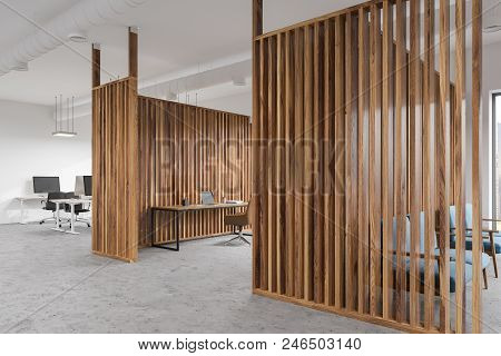 Interior Of A Manager S Office With Wooden Walls, Panoramic Windows, A Table And A Yellow Chair. Ope