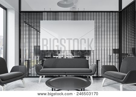 Loft Windows Office Waiting Room Interior With A Black Couch And Armchairs Near A Coffee Table Stand
