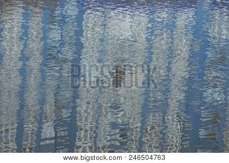 Texture Of The Reflection In The Water Of The Pond Of A Large House