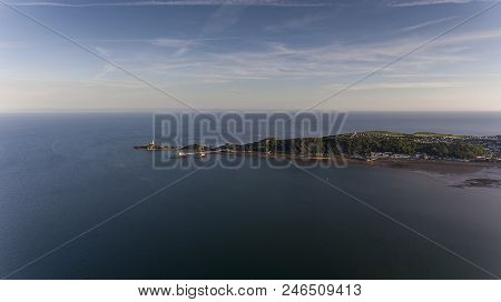 Editorial Swansea, Uk - June 22, 2018: The Coastline Along Mumbles Showing Mumbles Lighthouse And Th