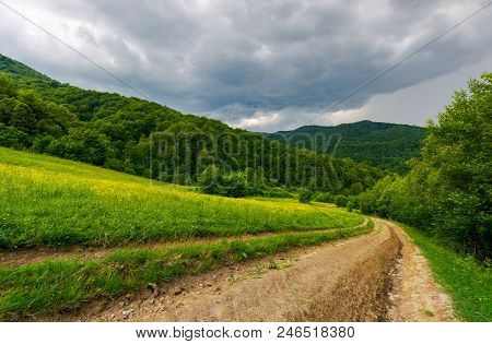 Country Road Down The Hill Through The Field. Lovely Countryside Scenery In Mountainous Area Before