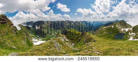 Panorama Of Fagaras Mountain Ridge In Summer. Beautiful View In To The Valley Of Beautiful Landscape