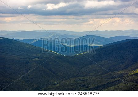 Hills Rolling Far In To The Distance. Beautiful Scenery Of Mountainous Summer Landscape.