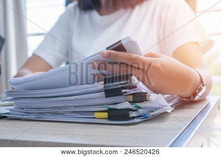 Business Documents Concept : Employee Woman Hands Working In Stacks Paper Files For Searching And Ch