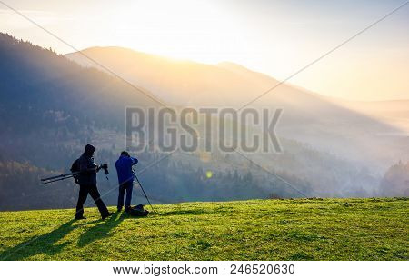 Photographers On Workshop At Sunrise. Capturing Gorgeous Scenery Of Mountainous Area From The Top Of