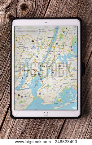 Uzhgorod, Ukraine - June 23, 2018: Ipad Pro 10.5 Inches With New York City Map On A Wooden Table.