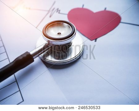 Closeup Head Of The Stepthoscope Put Beside Blurred Cutted Of Red Heart Paper And Heart Rate Drawing