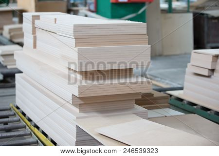 Piles of plywood. Wood processing shop. Wood billet poster
