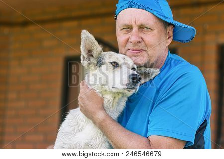 Nice Outdoor Portrait Of Two Happy Friends - Mature Man And His Lovely Young Dog