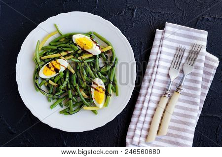 Fresh Summer Warm Salad With Cooked Green Beans With Boiled Eggs And Sauce Balsamico Glassa In White