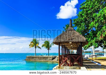 Luxury vacation in tropical resort. Mauritius island. Beachside restaurant in traditional style