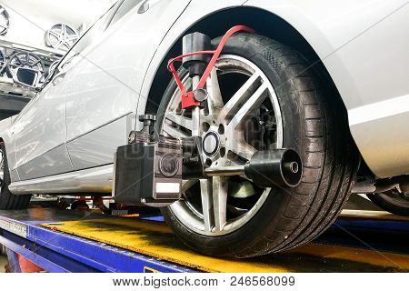 Car Undergo Wheel Align In Garage