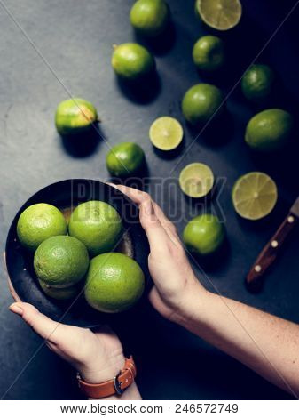 Closeup of hands with fresh lime
