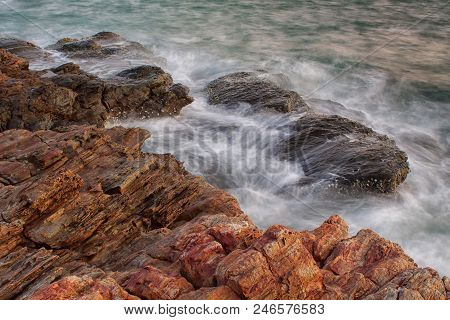 Ocean Waves Crashing To The Rocks In Evening