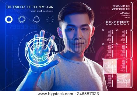 Attentive Look. Careful Concentrated Web Developer Thoughtfully Looking At The Transparent Screen An