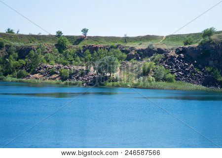 Beautiful Landscape Of A Cliff Near A Reservoir, Abandoned Quarry, Depth, Cliff, Grass, Stones, Sand