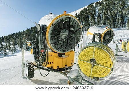 Yellow Snow Blower Machines Used For Preparing The Skiing In Dolomites. Snow Making Machine Close Up