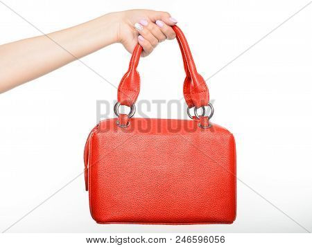 Female Hand Holding Red Style Leather Handbag Isolated