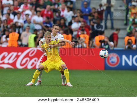 Marseille, France - June 21, 2016: Olexandr Zinchenko Of Ukraine (yellow) Fights For A Ball With Art