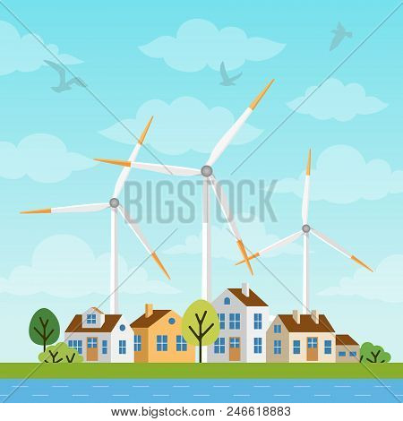 Landscape With Small Houses And Windmills On A Background Of Sky And Clowds. Wind Generator Turbines