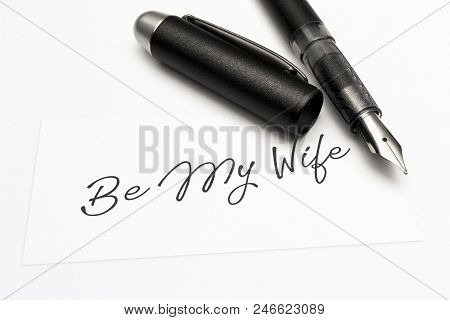 Close-up Of A Greeting Card With The Sweet Word, Be My Wife