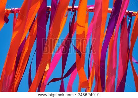 Multicolored Ribbons Flying In Windy Weather. Background