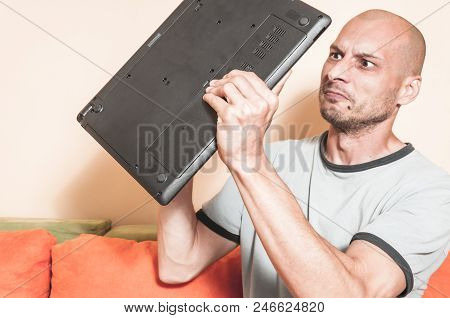 Angry Man Want To Break His Laptop Computer After System Crash Down In The Middle Of His Browsing Th