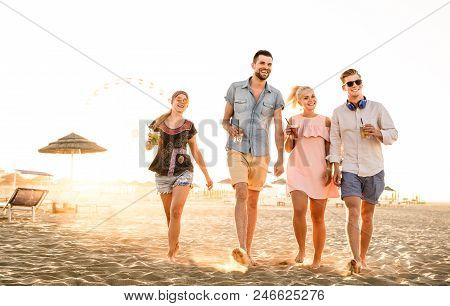Group Of Happy Friends Having Fun At Seaside Sunset - Summer Vacations And Friendship Concept With Y