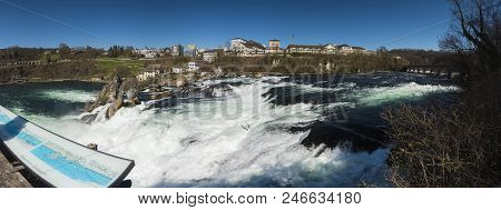 The Magic Of The Rhine Falls. The Biggest Waterfall In Europe In Panorama. The Border Between The Ca