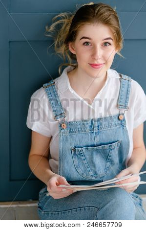 Crafty Lifestyle And Creative Personality Concept. Young Beautiful Girl Looking At Some Papers.