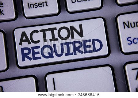 Conceptual hand writing showing Action Required. Business photo showcasing Important Act Needed Immediate Quick Important Task Text two words backspace button key press grey computer poster
