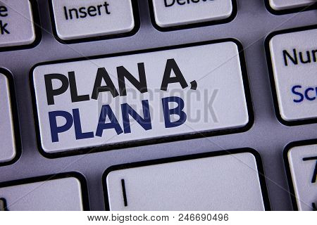 Conceptual hand writing showing Plan A, Plan B. Business photo showcasing Strategic Solutions Ideas Paths to follow to choose from Text two words backspace button key press grey computer poster
