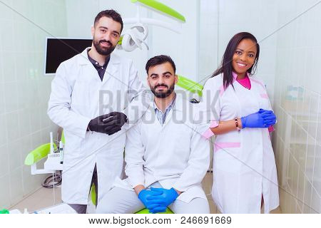 Friendly Young Multi Ethnic Personnel Group Graduated Dentist And Assistant Caucasian Blond And Afri