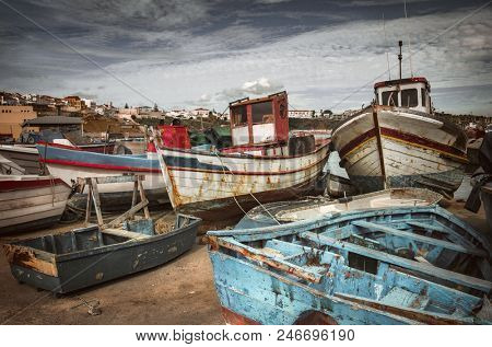 Old fishing boats docked in a port in Sines - Portugal