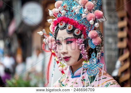 Chongqing, China - June 13, 2018 : Woman With Chinese Opera Traditional Dress And Make-up In Ciqikou