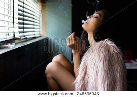 Charming Beautiful Sexy Woman Is Smoking Marijuana Or Cigarette. Attractive Beautiful Girl Feel Rela