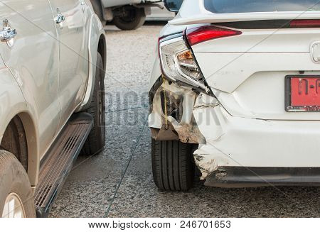 Vehicle Shows Damage At The Rear End Of The White Car.distracted Driver Rear Ended Vehicle At Stop S