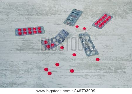 Top View Of The Pills On The White Background, The Drug And Capsule Pills On The Floor, Pile Of The