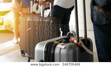 Airport Taxi. Passenger With Big Roller Luggage Standing On The Line Waiting For Taxi Queue At Taxi
