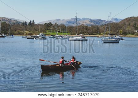 South Lakeland, Uk - April 2018: Tourists Rowing Boat On Scenic Lake Windermere In Lake District Nat