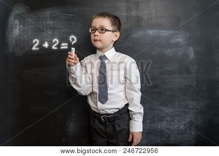 Young Kid's Solving Math's Expression. Back To School Concept. Augmented Reality. Smart And Clever P