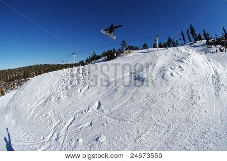 Snowboarder fly's high...