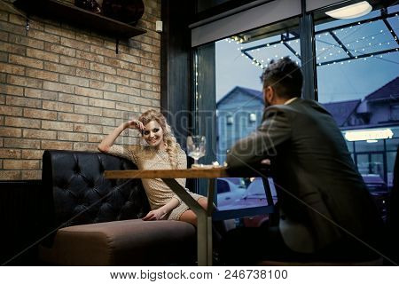 Date A Loving Couple. Couple In Love At The Restaurant. Valentines Day With Sexy Woman And Bearded M