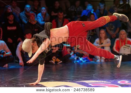 ST. PETERSBURG, RUSSIA - JUNE 1, 2018: Unidentified breakdancer performs during a battle of Red Bull BC One Camp Russia 2018. Red Bull BC One is the biggest one-on-one B-Boy competition in the world