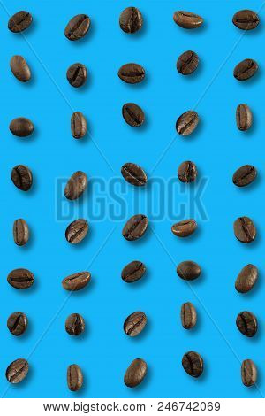 Coffee Bean On Blue Background Top Table View.