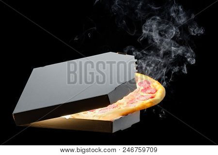 Hot Big Pepperoni Tasty Pizza In Open Cardboard Box, With Melting Cheese Steam Smoke On Black Backgr