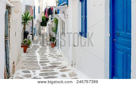 Narrow street with white houses, Greece