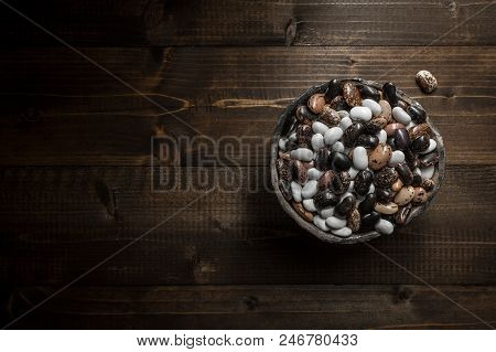 Organic Colorful Beans On Dark Wooden Background